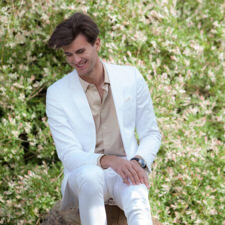 Young elegant handsome man posing outside. Stockfoto