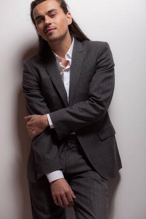 Handsome young elegant man studio portrait.