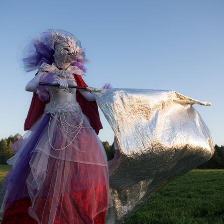 Fairy tale woman on stilts in bright fantasy stylization.