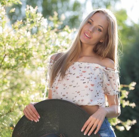Portrait of beautiful young girl in summer garden. Stock fotó