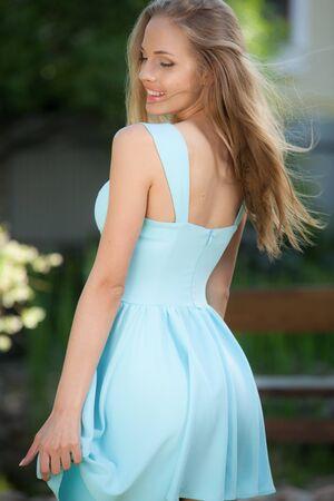 Portrait of beautiful young girl in summer garden. Imagens