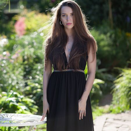 Portrait of beautiful young girl in summer garden.