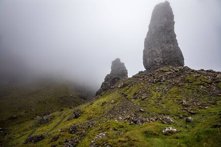 Old Man of Storr on the Isle of Skye in Scotland. Mountain landscape with foggy clouds