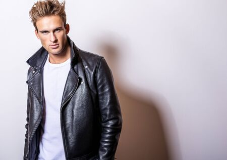 Handsome young man in classic leather jacket.