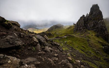 Old Man of Storr on the Isle of Skye in Scotland. Mountain landscape with foggy clouds. Reklamní fotografie