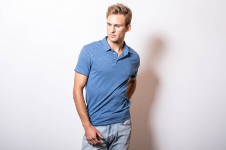 Elegant young handsome man in stylish blue shirt.
