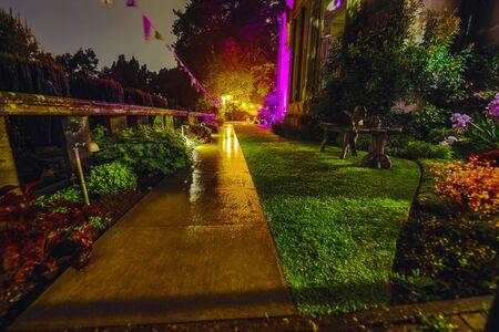 Multi-colored night lighting of the Scottish house garden