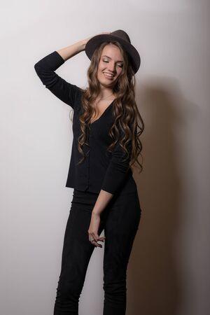 Young beautiful stylish girl posing in studio.