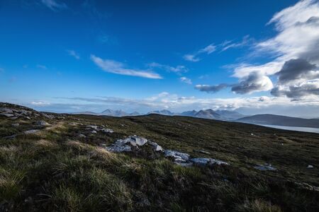 Beautiful mountains landscape of Scotland nature with beautiful evening cloudy sky.