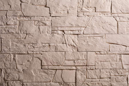 Decorative stone wall as background. High quality photo. 写真素材