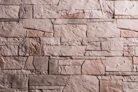 Decorative stone wall as background.