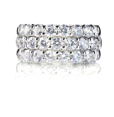 Beautiful diamond ring with diamonds set in gold. Fashion wedding or anniversary band. Фото со стока