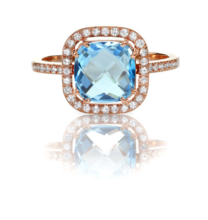 Beautiful Blue Topaz and diamond Rose Gold Halo Ring Cushion Cut with a square princess style setting 版權商用圖片 - 27864319