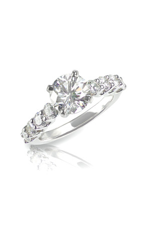 diamond stones: Beautiful diamond wedding ring set with multiple diamonds within a gold or platinum setting Stock Photo