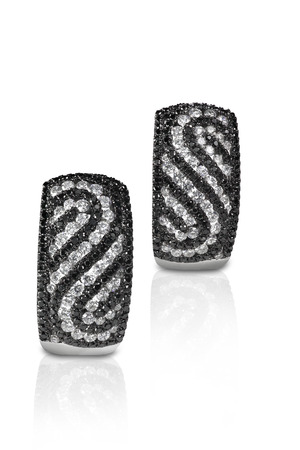 Black and White Diamond  Swirl Earrings isolated on white with reflections photo
