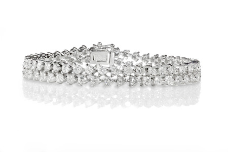 cuff bracelet: Double Row Diamond tennis Bracelet with back clasp Isolated on white.