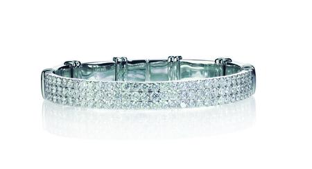 bangle: Multi Diamond bracelet. Silver in color in gold or platinum setting Stock Photo
