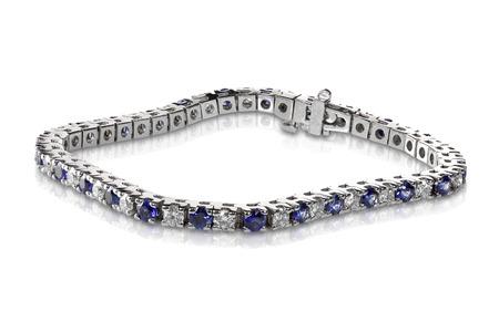 Diamond and Sapphire Tennis Bracelet isolated on white photo
