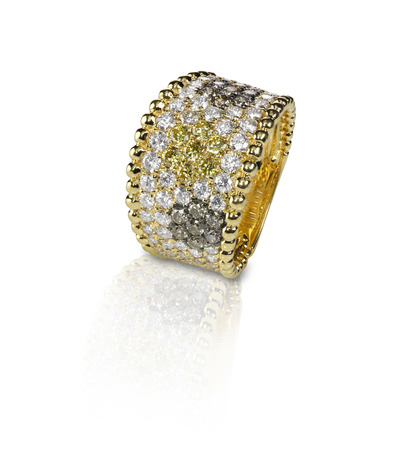 diamond stones: Fancy Colored diamond Pave ring with yellow brown and white stones. Isolated on white with a reflection