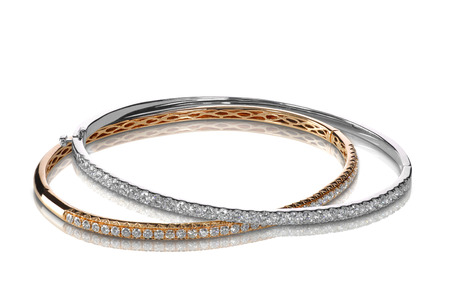 cuff bracelet: Set of diamond bracelets rose and white gold isolated on white with a shadow and reflection