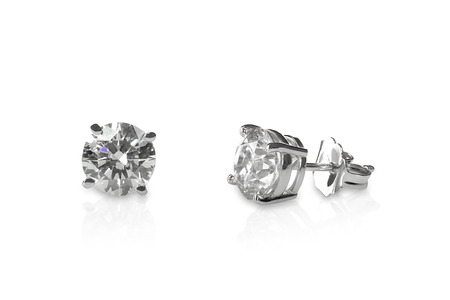 earring: Beautiful Diamond stud earrings isolated on white with a reflection