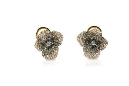 studs: Multi Colored chocolate white and black diamond floral earrings isolated on a white background with a reflection