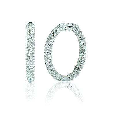 Large Diamond Pave hoop earrings isolated on a white background with reflection photo