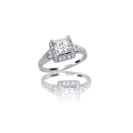 platinum: Beautiful Diamond Wedding band princess cut halo setting engagement ring isolated on white with a reflection