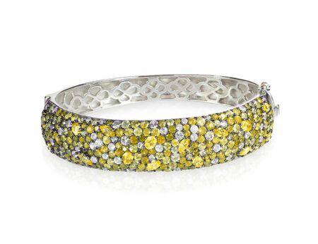bangle: Bangle Bracelet with yellow colored Diamonds or citrine or topaz isolated on white Stock Photo
