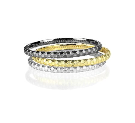 gold silver: Grouping of metal bangle Bracelets isolated on white with a reflection