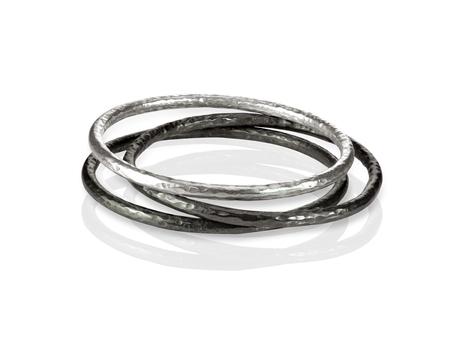 bangle: Stack of Metal Bangle Bracelets Stock Photo