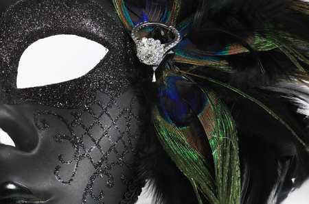 diamond ring: Elaborate Mardi Gras Mask with diamond ring and oeacock feathers Stock Photo