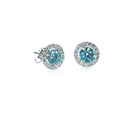 Blue Diamond stud earrings isolated on white Imagens