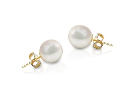 studs: White pearl pieced earrings pair fine jewelry isolated on white Stock Photo
