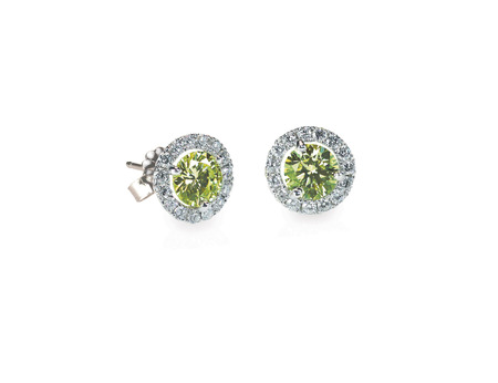 diamond earrings: Green Peridot and diamond earrings isolated on white Stock Photo