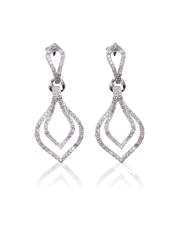 dangle: Diamond dangle drop earrings isolated on white