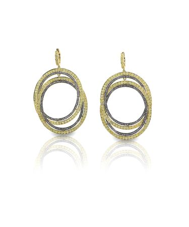 amber coloured: Yellow gold and diamond earrings isolated on white