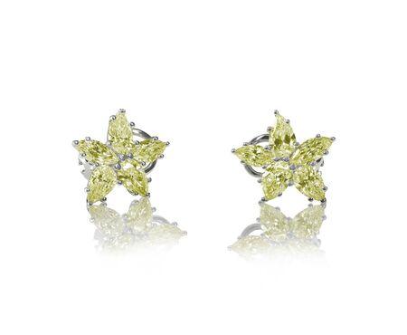 amber coloured: Yellow diamond citrine topaz stud earrings pair isolated on white