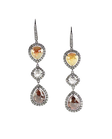 studs: Yellow gold and diamond earrings isolated on white quartz and amber