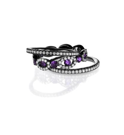 diamond rings: Diamond gemstone rings stacked together bridal wedding and engagement setting isolated on white Stock Photo