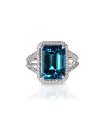 aquamarine center stone ring with diamond halo isolated on white Stock Photo