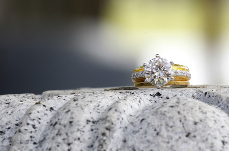 beatiful diamond ring sitting on granite stone