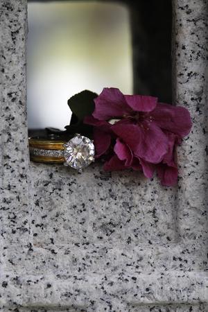 beatiful diamond ring sitting on granite stone
