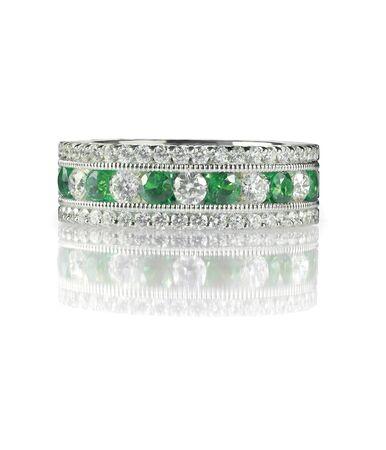 wedding band: green emerald and diamond wedding band ring isolated on white