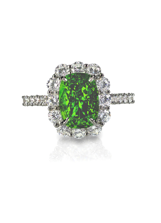 Emerald diamond helo engagment cocktail ring isolated on white