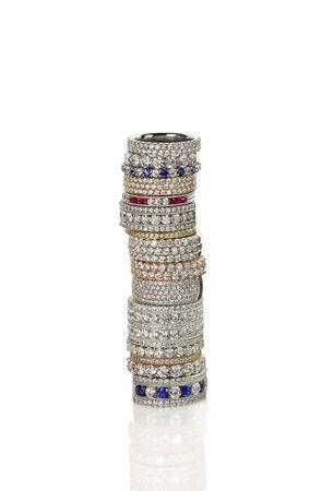 Diamond gemstone rings stacked together bridal wedding and engagement setting isolated on white Stock Photo