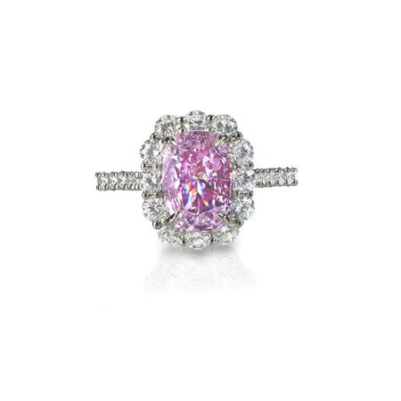 Pink diamond halo engagement wedding ring isolated on white