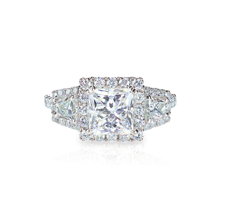 Diamond solitaire engagment wedding ring isolated on white Фото со стока