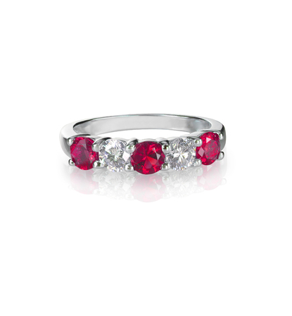 Ruby and diamond wedding anniversary band ring isolated on white