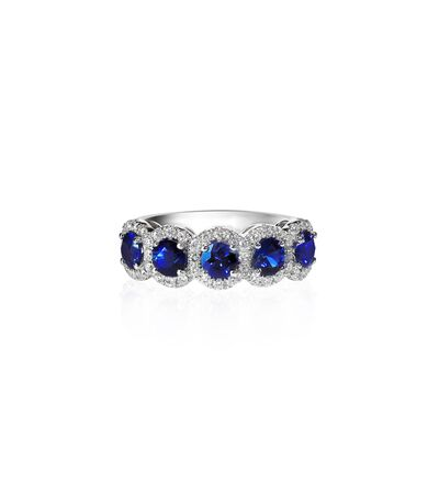 tanzanite: Sapphire and diamond wedding anniversary band isolated on white Stock Photo